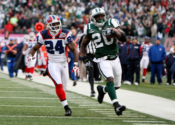 EAST RUtheRFORD, NJ - OCTOBER 18:  Thomas Jones #20 of the New York Jets scores a touchdown as Terrence McGee #24 of the Buffalo Bills defends during their game on October 18, 2009 at Giants Stadium in East Rutherford, New Jersey.  (Photo by Al Bello/Gett