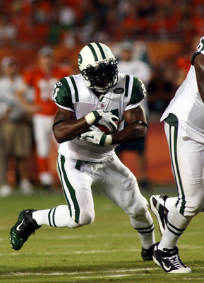 MIAMI - SEPTEMBER 26:  Running back LaDanian Tomlinson #21 of the New York Jets runs against the Miami Dolphins at Sun Life Stadium on September 26, 2010 in Miami, Florida.  (Photo by Marc Serota/Getty Images)