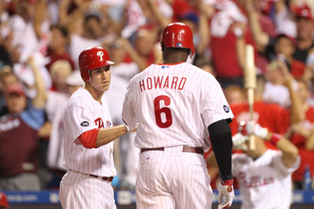 PHILADELPHIA - SEPTEMBER 25: First baseman Ryan Howard #6 of the Philadelphia Phillies is greeted at home plate by second baseman Chase Utley #26 after hitting a first inning two-run home run during a game against the New York Mets at Citizens Bank Park o