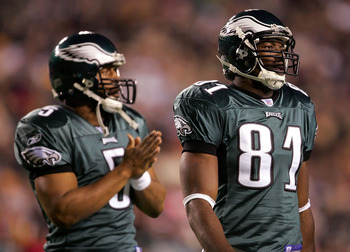 LANDOVER, MD - DECEMBER 12:   Reciever Terrell Owens #81 and quarterback Donovan McNabb #5 of the Philadelphia Eagles watch during the first half of the game against the Washington Redskins at Fed Ex Field on December 12, 2004 in Landover, Maryland.  (Pho