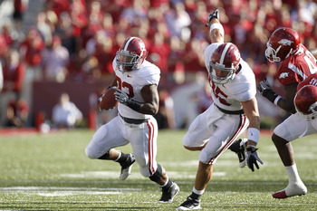 FAYETTEVILLE - SEPTEMBER 25: Mark Ingram #22 of the Alabama Crimson Tide runs the ball against the Arkansas Razorbacks at Donald W. Reynolds Razorback Stadium on September 25, 2010 in Fayetteville, Arkansas. Alabama won 24-20. (Photo by Joe Robbins/Getty