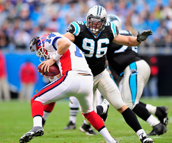 CHARLOTTE, NC - OCTOBER 25:  Tyler Brayton #96 of the Carolina Panthers sacks Ryan Fitzpatrick #14 of the Buffalo Bills during the second quarter at Bank of America Stadium on October 25, 2009 in Charlotte, North Carolina.  (Photo by Grant Halverson/Getty