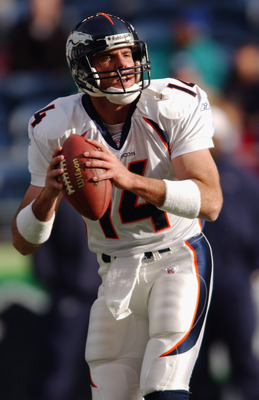 SEATTLE - NOVEMBER 17:  Quarterback Brian Griese #14 of the Denver Broncos looks to pass during the NFL game against the Seattle Seahawks at Seahawks Stadium on November 17, 2002 in Seattle, Washington. The Broncos defeated the Seahawks 31-9.  (Photo by O