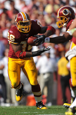 LANDOVER, MD - SEPTEMBER 19:  Clinton Portis #26 of the Washington Redskins runs22 the ball during the game against the Houston Texans at FedExField on September 19, 2010 in Landover, Maryland. The Texans defeated the Redskins in overtime 30-27. (Photo by