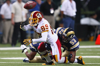 ST. LOUIS - SEPTEMBER 26: Na'Il Diggs #53 of the St. Louis Rams forces a fumble against Santana Moss #89 of the Washington Redskins at the Edward Jones Dome on September 26, 2010 in St. Louis, Missouri.  The Rams beat the Redskins 30-16.  (Photo by Dilip