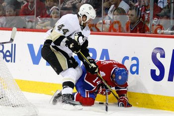 MONTREAL- MAY 6:  Brooks Orpik #44 of the Pittsburgh Penguins and Tomas Plekanec #14 of the Montreal Canadiens collide in Game Four of the Eastern Conference Semifinals during the 2010 NHL Stanley Cup Playoffs at the Bell Centre on May 6, 2010 in Montreal