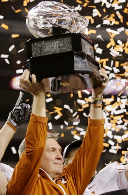 ARLINGTON, TX - DECEMBER 5: Head coach Mack Brown of the Texas Longhorns lifts the trophy after his teams 10-6 victory over the Nebraska Cornhuskers in the game at Cowboys Stadium on December 5, 2009 in Arlington, Texas.  (Photo by Jamie Squire/Getty Imag