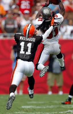 TAMPA, FL - SEPTEMBER 12:  Cornerback E.J. Biggers #31 of the Tampa Bay Buccaneers intercepts a pass intended for receiver Mohamed Massaquoi #11 of the Cleveland Browns during the NFL season opener game at Raymond James Stadium on September 12, 2010 in Ta