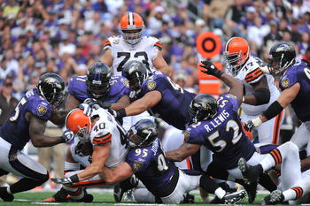BALTIMORE - SEPTEMBER 26:  Peyton Hills #40 of the Cleveland Browns is stopped by the Baltimore Ravens defense at M&T Bank Stadium on September 26, 2010 in Baltimore, Maryland. The Ravens defeated the Browns 24-17. (Photo by Larry French/Getty Images)