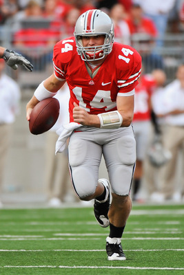 COLUMBUS, OH - SEPTEMBER 25:  Joe Bauserman #14 of the Ohio State Buckeyes runs with the ball against the Eastern Michigan Eagles at Ohio Stadium on September 25, 2010 in Columbus, Ohio.  Ohio State won 73-20. (Photo by Jamie Sabau/Getty Images)