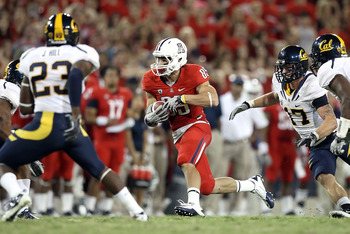 TUCSON, AZ - SEPTEMBER 25:  Wide receiver David Douglas #85 of the Arizona Wildcats runs with the football during the college football game against the California Golden Bears at Arizona Stadium on September 25, 2010 in Tucson, Arizona.   The Wildcats def