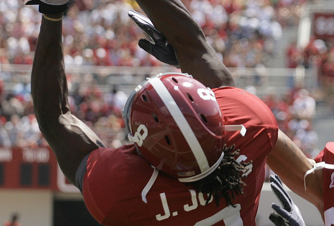 TUSCALOOSA, AL - APRIL 17:  Receiver Julio Jones #8 of the University of Alabama catches a pass as DeMarcus Milliner #28 defends during the Alabama spring game at Bryant Denny Stadium on April 17, 2010 in Tuscaloosa, Alabama. (Photo by Dave Martin/Getty I