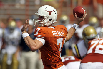 AUSTIN, TX - SEPTEMBER 25:  Quarterback Garrett Gilbert #7 of the Texas Longhorns looks to pass against the UCLA Bruins at Darrell K Royal-Texas Memorial Stadium on September 25, 2010 in Austin, Texas.  (Photo by Ronald Martinez/Getty Images)