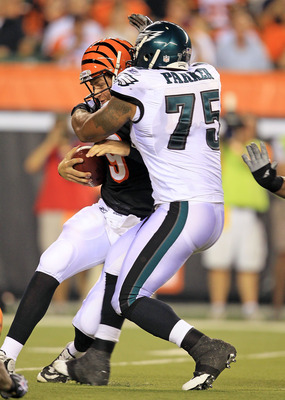 CINCINNATI - AUGUST 20:  Carson Palmer #9 of the Cincinnati Bengals is sacked by Juqua Parker #75 of  the Philadelphia Eagles during the NFL preseason game at Paul Brown Stadium on August 20, 2010 in Cincinnati, Ohio.  (Photo by Andy Lyons/Getty Images)