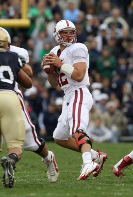 SOUTH BEND, IN - SEPTEMBER 25: Andrew Luck #12 of the Stanford Cardinal looks for a receiver against the Notre Dame Fighting Irish at Notre Dame Stadium on September 25, 2010 in South Bend, Indiana. Stanford defeated Notre Dame 37-14. (Photo by Jonathan D