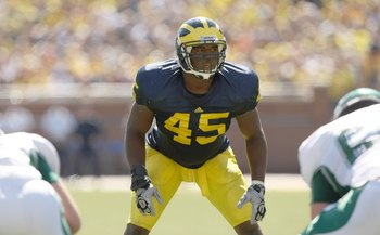 ANN ARBOR, MI - SEPTEMBER 19:  Middle linebacker Obi Ezeh #45 of the Michigan Wolverinesets for a play against the Eastern Michigan Eagles at Michigan Stadium on September 19, 2009 in Ann Arbor, Michigan.  Michigan won 45-17.  (Photo by Stephen Dunn/Getty