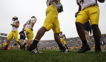 SOUTH BEND, IN - SEPTEMBER 11: Members of the Michigan Wolverine defense including Craig Roh #88 and Paul Gyarmati #59 participate in warm-ups beofre a game against the Notre Dame Fighting Irish  at Notre Dame Stadium on September 11, 2010 in South Bend,