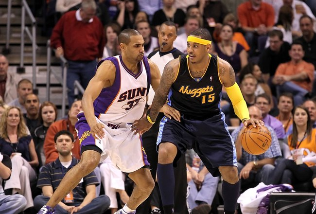 PHOENIX - APRIL 13:  Carmelo Anthony #15 of the Denver Nuggets handles the ball during the NBA game against the Phoenix Suns at US Airways Center on April 13, 2010 in Phoenix, Arizona. The Suns defeated the Nuggets 123-101.  NOTE TO USER: User expressly a