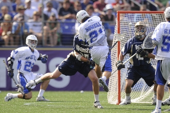 BALTIMORE, MD - MAY 31:  Zach Howell #21 of the Duke Blue Devils takes a shot against the Notre Dame Fighting Irish during the 2010 NCAA Division 1 Lacrosse Championship game on May 31, 2010 at M&T Bank Stadium in Baltimore, Maryland.  (Photo by Mitchell