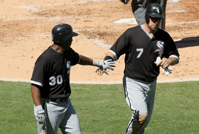 ANAHEIM, CA - SEPTEMBER 26:  Mark Kotsay #7 of the Chicago White Sox is greeted by Alejandro De Aza #30 after scoring on a sacrifice fly in the second inning against the Los Angeles Angels of Anaheim in the second inning on September 26, 2010 at Angel Sta