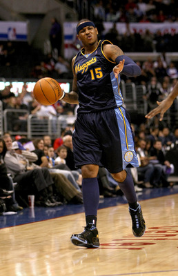 LOS ANGELES - NOVEMBER 20: Carmelo Anthony #15 of the Denver Nuggets signals as he controls the ball against the Los Angeles Clippers on November 20, 2009 at Staples Center in Los Angeles, California.     NOTE TO USER: User expressly acknowledges and agre