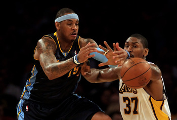 LOS ANGELES, CA - FEBRUARY 28:  Carmelo Anthony #15 of the Denver Nuggets has the ball knocked away by Ron Artest #37 of the Los Angeles Lakers during the first half at Staples Center on February 28, 2010 in Los Angeles, California.  NOTE TO USER: User ex
