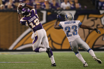 MINNEAPOLIS - SEPTEMBER 26:  Wide receiver Percy Harvin #12 of the Minnesota Vikings makes a catch for a reception in front of Chris Houston #23 of the Detroit Lions during the first half at Hubert H. Humphrey Metrodome on September 26, 2010 in Minneapoli