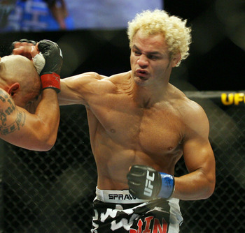 CHICAGO- OCTOBER 25: Josh Koscheck (R) punches Thiago Alves in a Welterweight bout  at UFC's Ultimate Fight Night at Allstate Arena on October 25, 2008 in Chicago, Illinois. (Photo by Tasos Katopodis/Getty Images)