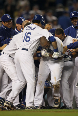 LOS ANGELES, CA - JUNE 01:  Andre Ethier #16 of the Los Angeles Dodgers puts Matt Kemp #27 in a headlock as the Dodgers celebrate at home plate after Kemp's walk off home run in the tenth inning against the Arizona Diamondbacks on June 1, 2010 at Dodger S