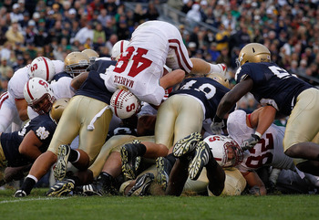 SOUTH BEND, IN - SEPTEMBER 25: Owen Marecic #48 of the Stanford Cardinal jumps over the line to score an offensive touchdown against the Notre Dame Fighting Irish at Notre Dame Stadium on September 25, 2010 in South Bend, Indiana. Stanford defeated Notre
