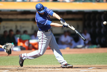 OAKLAND, CA - SEPTEMBER 26:  Jeff Francoeur #21 of the Texas Rangers hits an RBI single against the Oakland Athletics during a Major League Baseball game at the Oakland-Alameda County Coliseum on September 26, 2010 in Oakland, California.  (Photo by Jed J