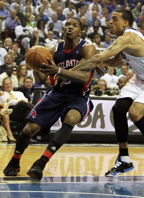 ORLANDO, FL - MAY 04:  Joe Johnson #2 of the Atlanta Hawks drives past Matt Barnes #22 of the Orlando Magic in Game One of the Eastern Conference Semifinals during the 2010 NBA Playoffs at Amway Arena on May 4, 2010 in Orlando, Florida. NOTE TO USER: User