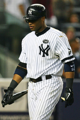 NEW YORK - SEPTEMBER 24: Robinson Cano #24 of the New York Yankees walks back to the dug out after striking out swinging in the ninth inning against the Boston Red Sox on September 24, 2010 at Yankee Stadium in the Bronx borough of New York City.  The Red