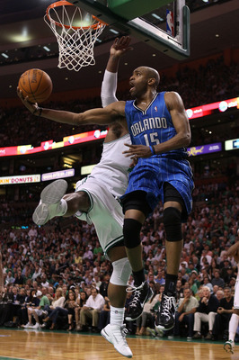 BOSTON - MAY 22:  Vince Carter #15 of the Orlando Magic drives for a shot attempt against Glen Davis #11 of the Boston Celtics at TD Banknorth Garden in Game Three of the Eastern Conference Finals during the 2010 NBA Playoffs on May 22, 2010 in Boston, Ma
