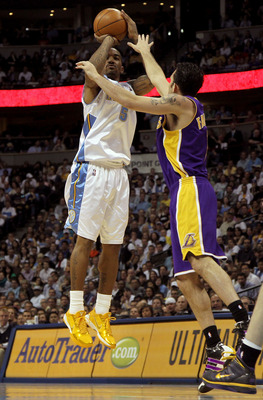 DENVER - APRIL 08:  J.R. Smith #5 of the Denver Nuggets takes a shot over Jordan Farmer #1 of the Los Angeles Lakers during NBA action at the Pepsi Center on April 8, 2010 in Denver, Colorado. The Nuggets defeated the Lakers 98-96. NOTE TO USER: User expr