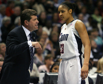 ST. LOUIS - APRIL 07:  Head coach Geno Auriemma of the Connecticut Huskies talks with Maya Moore #23 in the first half against the Louisville Cardinals  on April 7, 2009 during the NCAA Women's Final Four Championship game at the Scottrade Center on April