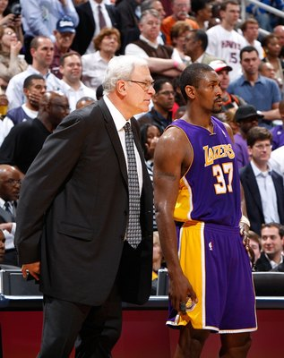 ATLANTA - MARCH 31:  Head coach Phil Jackson and Ron Artest #37 of the Los Angeles Lakers against the Atlanta Hawks at Philips Arena on March 31, 2010 in Atlanta, Georgia.  NOTE TO USER: User expressly acknowledges and agrees that, by downloading and/or u