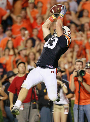 AUBURN, AL - SEPTEMBER 25:  Philip Lutzenkirchen #43 of the Auburn Tigers pulls in this go-ahead touchdown reception against the South Carolina Gamecocks at Jordan-Hare Stadium on September 25, 2010 in Auburn, Alabama.  (Photo by Kevin C. Cox/Getty Images