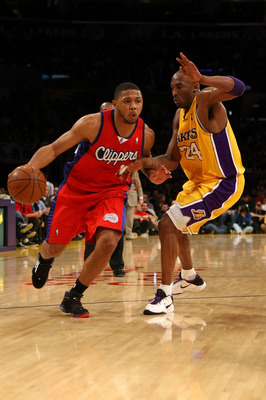 LOS ANGELES, CA - JANUARY 15:  Eric Gordon #10 of the Los Angeles Clippers drives against Kobe Bryant #24 of the Los Angeles Lakers in the third quarter during the game on January 15, 2010 at Staples Center in Los Angeles, California. NOTE TO USER: User e