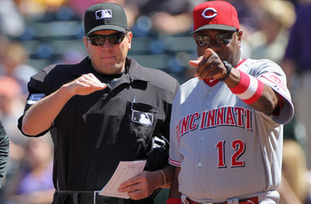 DENVER - SEPTEMBER 06:  Home plate umpire Chad Fairchild reviews the stadium ground rules with manager Dusty Baker #12 the Cincinnati Reds as they face the Colorado Rockies at Coors Field on September 6, 2010 in Denver, Colorado. The Rockies defeated the