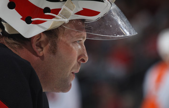 NEWARK, NJ - SEPTEMBER 28:  Martin Brodeur #30 of the New Jersey Devils takes a break during his game against the Philadelphia Flyers at the Prudential Center on September 28, 2010 in Newark, New Jersey.  (Photo by Bruce Bennett/Getty Images)