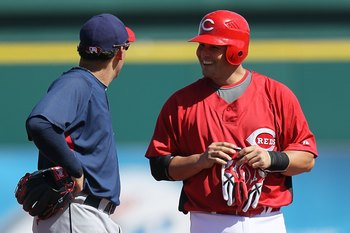 GOODYEAR, AZ - MARCH 05: Asdrubal Cabrera #13 of the Cleveland Indians talks with Ramon Hernandez #55 of the Cincinnati Reds during a spring training game at Goodyear Ballpark on March 5, 2010 in Goodyear, Arizona.  (Photo by Chris McGrath/Getty Images)