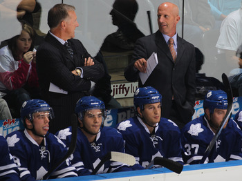 LONDON,ON - SEPTEMBER 23: Head Coach Ron Wilson and assistant Keith Acton of the Toronto Maple Leafs confer in a pre-season game against the Philadelphia Flyers on September 23,2010 at the John Labatt Centre in London, Ontario. The Leafs defeated the Flye