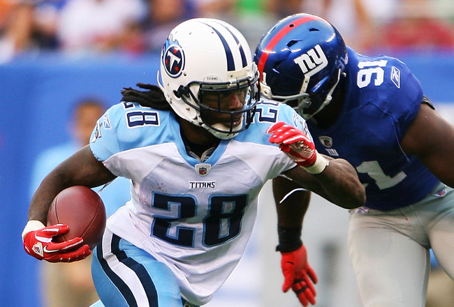 EAST RUTHERFORD, NJ - SEPTEMBER 26: Chris Johnson #28 of the Tennessee Titans runs the ball past Justin Tuck #91 of the New York Giants at New Meadowlands Stadium on September 26, 2010 in East Rutherford, New Jersey. The Titans beat the Giants 29 - 10. (P
