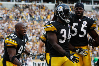 PITTSBURGH - SEPTEMBER 12:  Rashard Mendenhall #34 of the Pittsburgh Steelers celebrates with teammates Stevenson Sylvester #55 and James Harrison #92 after scoring the game winning touchdown on a 50-yard run against the Atlanta Falcons during the NFL sea