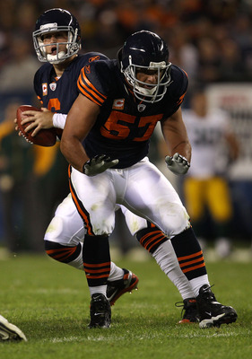 CHICAGO - SEPTEMBER 27:  Center Olin Kreutz #57 of the Chicago Bears blocks for quarterback Jay Cutler #6 against the Green Bay Packers at Soldier Field on September 27, 2010 in Chicago, Illinois. The Bears won 20-17. (Photo by Jonathan Daniel/Getty Image