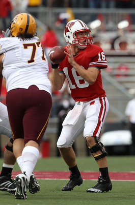 MADISON, WI - SEPTEMBER 18: Scott Tolzien #16 of the Wisconsin Badgers looks for a receiver under pressure from Saia Falahola #77 of the Arizona State Sun Devils at Camp Randall Stadium on September 18, 2010 in Madison, Wisconsin. Wisconsin defeated Arizo