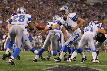 MINNEAPOLIS - SEPTEMBER 26:  Quarterback Shaun Hill #14 of the Detroit Lions hands the ball off to Maurice Morris #28 during the second half against the Minnesota Vikings at Hubert H. Humphrey Metrodome on September 26, 2010 in Minneapolis, Minnesota.  Th