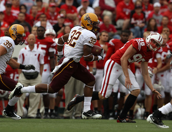 MADISON, WI - SEPTEMBER 18: Jamal Miles #32 of the Arizona State Sun Devils returns a kick as Brad Nortman #98 of the Wisconsin Badgers gives chase at Camp Randall Stadium on September 18, 2010 in Madison, Wisconsin. Wisconsin defeated Arizona State 20-19