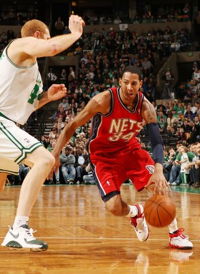 BOSTON - FEBRUARY 27:  Devin Harris #34 of the New Jersey Nets drives to the net as Brian Scalabrine #44 of the Boston Celtics defends at the TD Garden on February 27, 2010 in Boston, Massachusetts. The Nets defeated the Celtics 104-96.  NOTE TO USER: Use